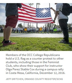 Members of the OCC College Republicans hold a U.S. flag as a counter protest to other students, including those in the Feminist Club, who show their support for instructor Olga Perez Stable Cox during a campus rally in Costa Mesa, California, December 12, 2016.  Jeff Gritchen, Orange County Register/SCNG
